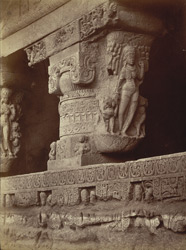 One of front pillars from Ramesvara [Close view of pillar at entrance to Hindu Cave XXI (Ramesvara), Ellora.]